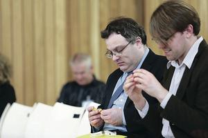 Employment Minister Stephen Farry and Patrick Brophy of SAP get to grips with making a duck out of pieces of Lego