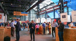 Visitors mill around at the Money Conf at T13 in Belfast yesterday