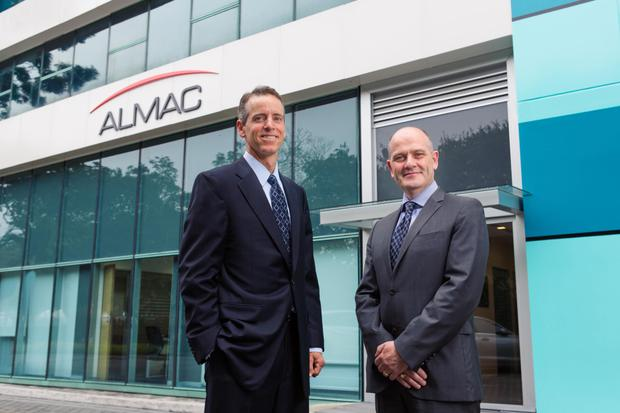 Almac managing directors Jim Murphy and Dr Robert Dunlop in Singapore.
