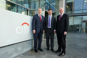 First and Deputy First Ministers Peter Robinson and Martin McGuinness yesterday at Citi's offices in Belfast with James Bardrick, Citi country officer for the United Kingdom
