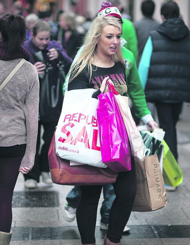 A Christmas shopper in Belfast's city centre. Several supermarkets have already booked entire commercial breaks for single three minute epic ads
