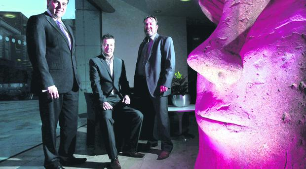 Alastair Hamilton, Invest NI, with Corin Hawthorne and Colm O'Farrell from The Deluxe Group