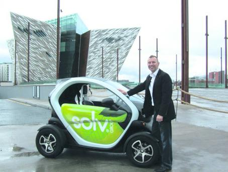Stephen Kane, managing director of Solv Group, with the Renault Twizy