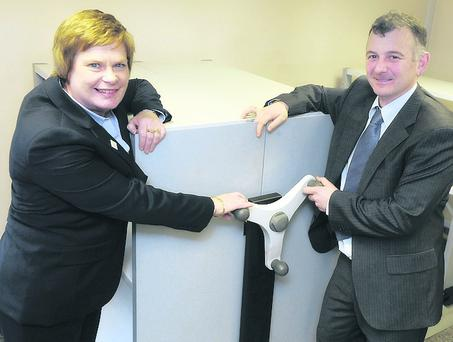 Dr Vicky Kell, Invest NI trade director, and Peter Gormley, managing director of Sperrin Metal