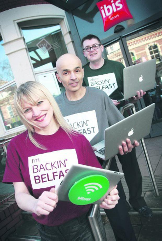 Julie Fitzsimmons, from Park Plaza, Belfast, with Rajesh Rana (centre) from Andras House and Russell McQuillan, from Bitbuzz