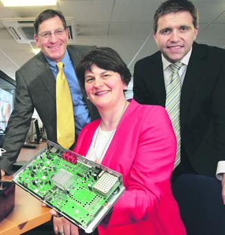 Out of the box: Enterprise Minister Arlene Foster yesterday with (left) Latens president Carmi Bogot and senior VP Mark Crum