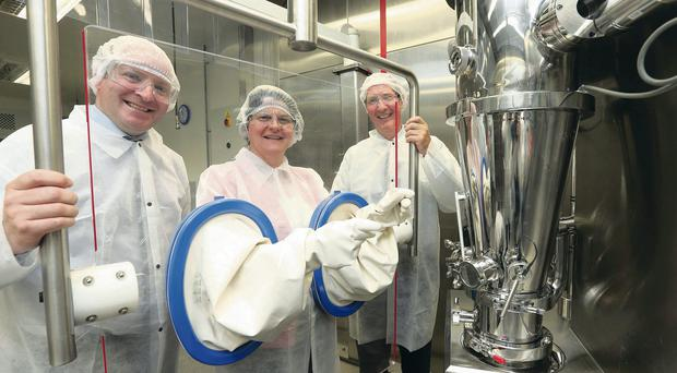 Gloves on: Enterprise Minister Arlene Foster is joined on a tour of Almac's Formulation Suite by Graeme McBurney (left), managing director of Pharma Services, Almac and Alan Armstrong, CEO Almac