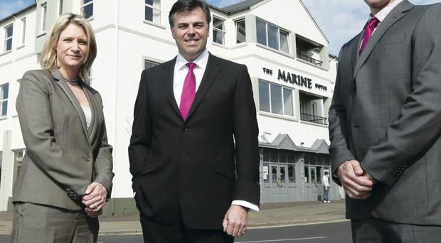 New era: Alastair Hamilton of Invest NI with the new owners of the Marine Hotel Claire Hunter and Colum McLornan