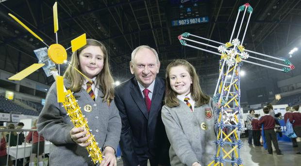 Young innovators: Julia Marrow and Emily Richardson from Antrim PS show their energy project to Jim Stewart, chairman of Sentinus