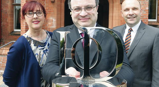 Employment and Learning Minister Dr Stephen Farry launchewd the 2013-14 Institute of Directors NI Director of the Year Awards with IoD director Linda Brown and Maurice Boyd, managing director of awards sponsor Abbey Bond Lovis