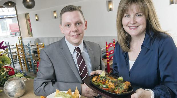 Local restaurant entrepreneur Patricia Carson and Marc Ashby from First Trust Bank