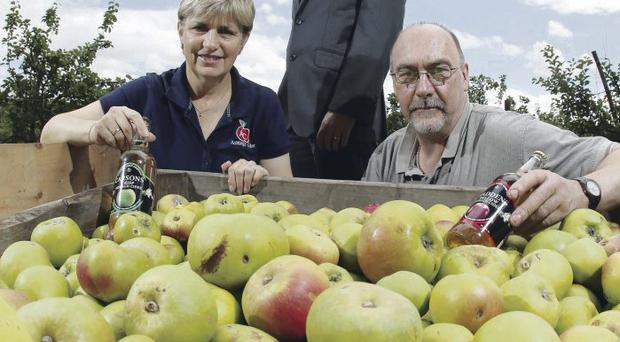 Helen and Philip Troughton, owners of the Armagh Cider Company, with Neil McCabe (centre) from WhiteRock Capital Partners which manages the Growth Loan Fund