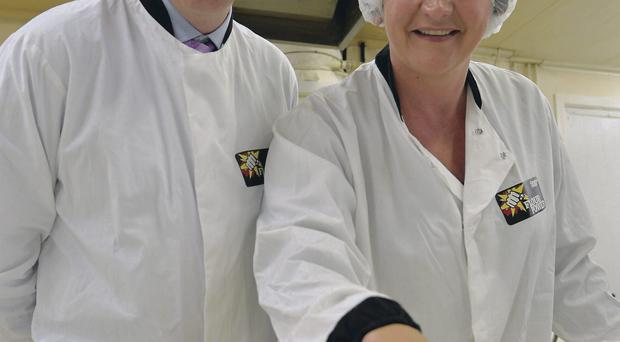 Enterprise Minister Arlene tours McErlain's Bakery in Magherafelt with the family food company's Managing Director