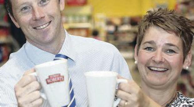 Cup win: Maria Losty from Robert Roberts and Tesco's Steven Murphy with the brand