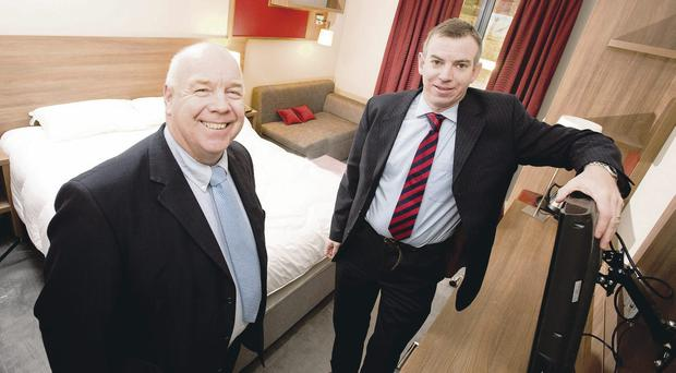 Making progress: Invest NI's Ian Murphy with Eamonn Connolly of Warrenpoint-based firm Sipfit which has benefited from the Invest NI Business Growth Programme