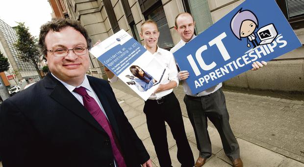 Employment Minister Stephen Farry launched the second IT apprenticeship scheme with the help of Peter Brimstone (left), now employed at Liberty IT, and Martin Fox (right), now working at Kainos