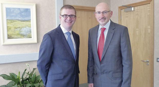 Finance Minister Simon Hamilton welcomes the director of the Public Sector Reform Division