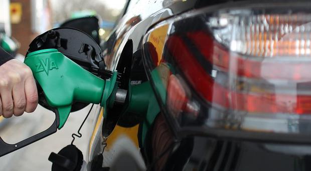 Retailers have been urged to cut the price of petrol.