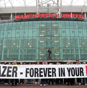 Manchester United fans protest about the club's debt position prior to a game at Old Trafford in 2010.