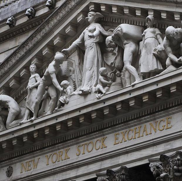 The New York Stock Exchange. Wall Street closed at a record high after the Federal Reserve decided to keep its economic stimulus in place.