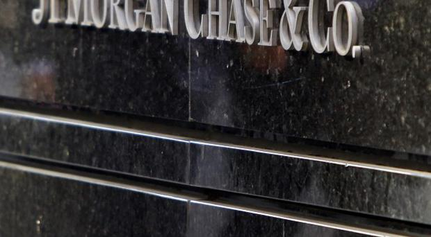 US investment bank JP Morgan Chase has been fined 920 million US dollars (£572 million) over a high risk trading scandal (AP)