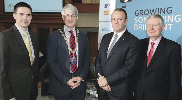 At the event in Titanic Belfast yesterday are (from left) David Manning from Airtricity, Mark Nodder from the NI Chamber of Commerce, Leigh Meyer from Citigroup, and Dale Farm's David Dobbin