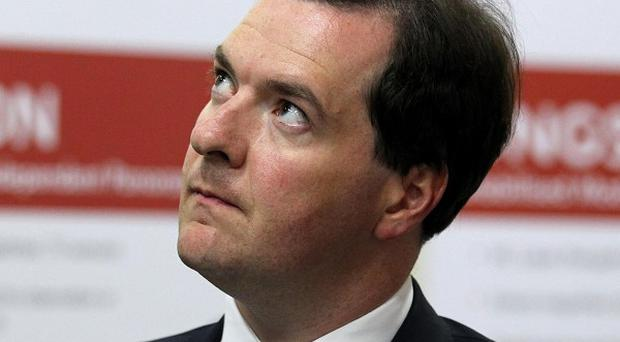 George Osborne's deficit-busting plans were boosted by news that Government borrowing is down