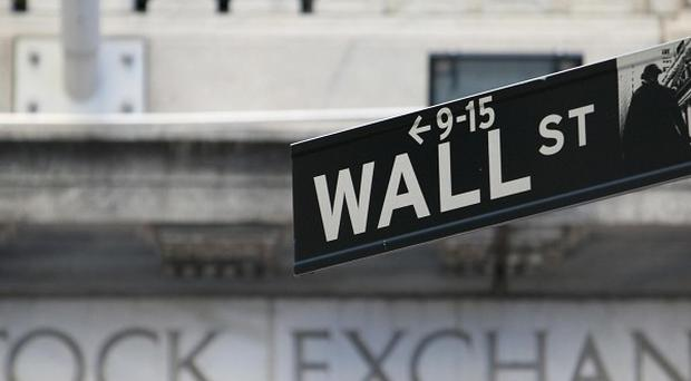 The Dow Jones industrial average dropped 185 points to close at 15,451