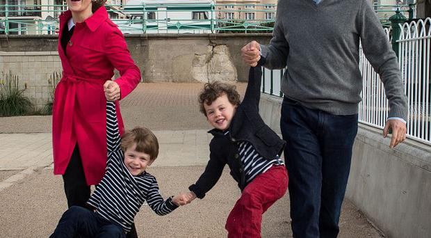Labour leader Ed Miliband and his wife Justine take their children Daniel (left) and Sam (right) for a walk along Brighton beach on the eve of the Labour Party annual conference.