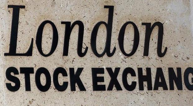 The FTSE 100 Index has started the week on the back foot, despite Angela Merkel's election success.