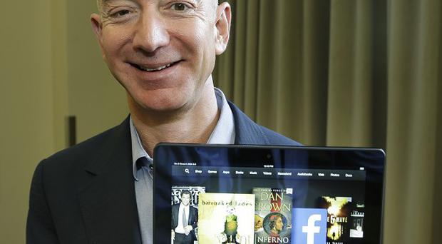 Jeff Bezos, CEO of Amazon.com, with the 8.9-in version of the new Amazon Kindle HDX tablet computer.