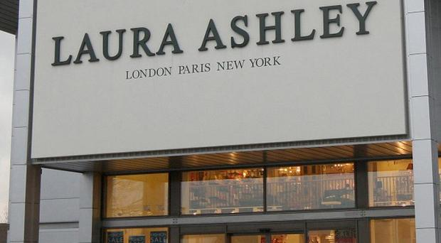 Laura Ashley's half-year profits fell 11% due to poor fashion sales and difficult weather conditions.