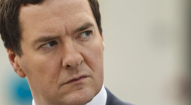 George Osborne has filed a formal complaint against Brussels over plans to cap bankers' bonuses