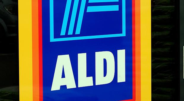 Discount supermarket Aldi has pledged to open 50 new stores in the UK this year after earning a record profits haul and boosting its market share