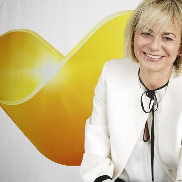 Thomas Cook chief executive Harriet Green and the company's Sunny Heart logo.