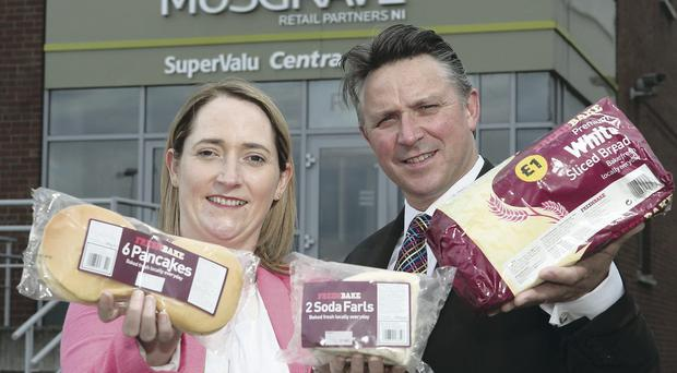 Toasting the 'own brand' bread deal covering 120 stores is Seamus Gillespie, Irwin's Bakery sales manager and Lisa Muldoon, Musgrave Retail Partners NI