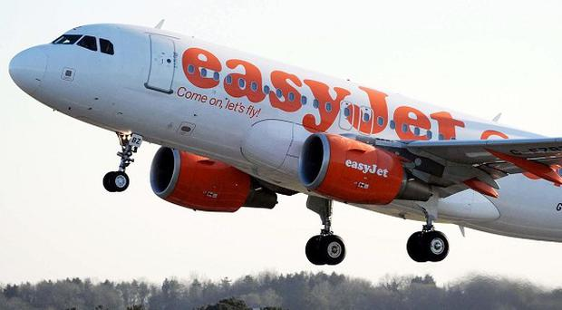 easyJet expects annual profits of between 470 million pounds and 480 million pounds