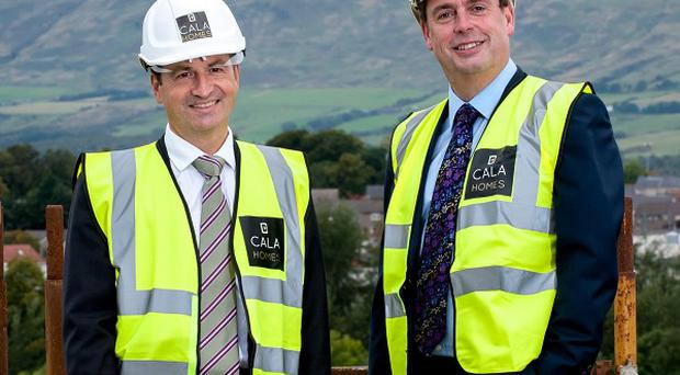 CALA finance director Graham Reid (left) and chief executive Alan Brown celebrate record profits for the housebuilder. (CALA/Press Association)