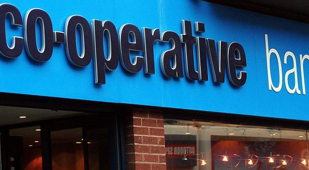 The Co-operative Bank has removed four directors from its board