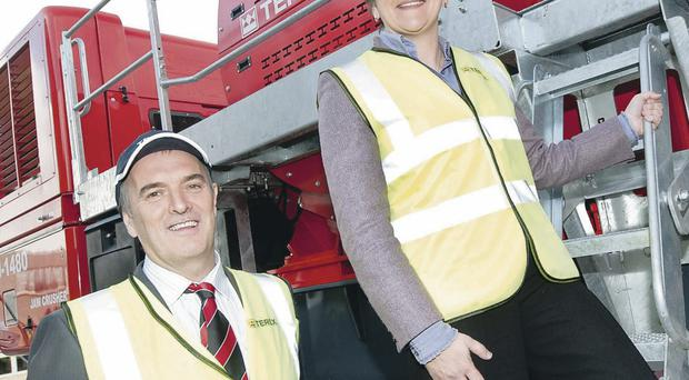 Arlene Foster is pictured with Kieran Hegarty, President of Terex Materials Processing