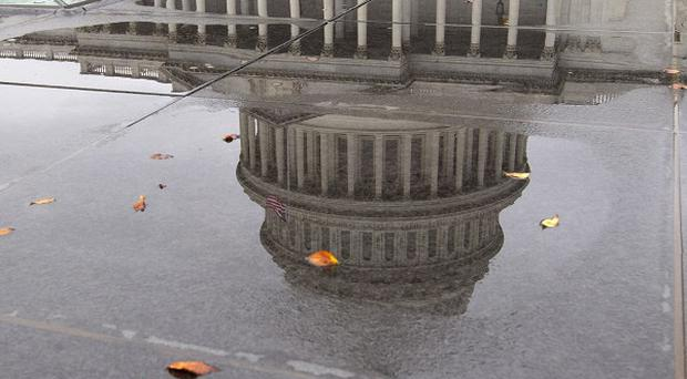 The US federal government remains partially shut down and faces the prospect of a first-ever default (AP)