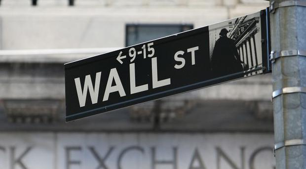 The Dow Jones industrial average fell 133 points to close at 15,168 points