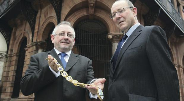 New chairman of RICS Northern Ireland Paul Kendrick receives the chain of office from out-going chairman Michael Hannaway
