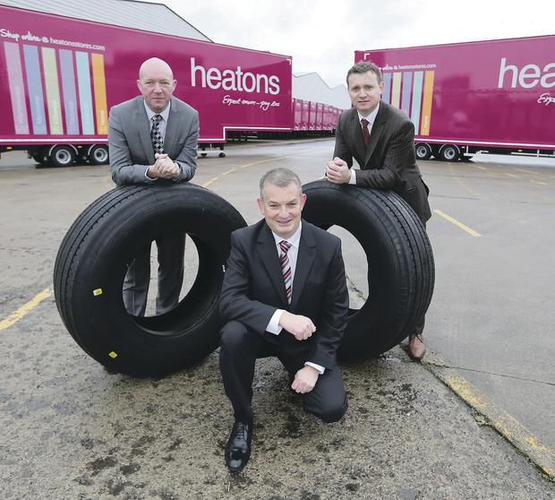 Sam O'Prey, customer service manager for HireCo, Enda Cushnahan, commercial director SDC Trailers, and Sean McErlean, head of distribution at Heatons