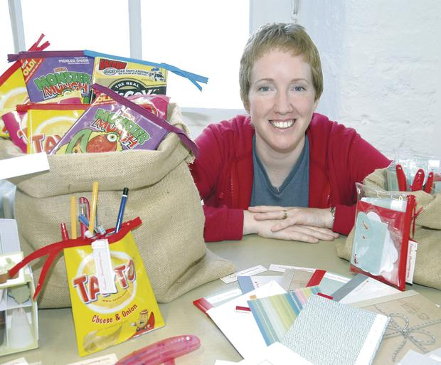 Louise Firinne with a selection of her company Simply Rouge's product line of stationery and giftware. She now has a pop-up shop in London and has the Prince's Trust to thank for her success