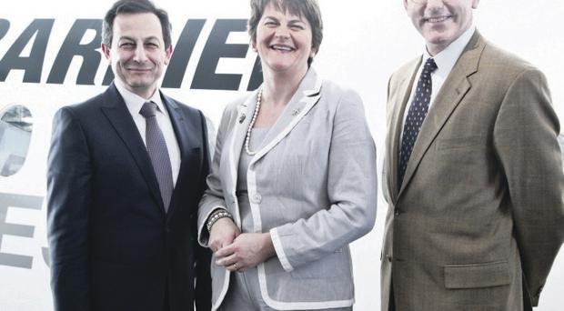Arlene Foster is pictured at the Dubai Air Show congratulating (L-R): Mike Arcamone, President, Commercial Aircraft Bombardier and Chet Fuller, Senior Vice President, Sales Commercial Aircraft