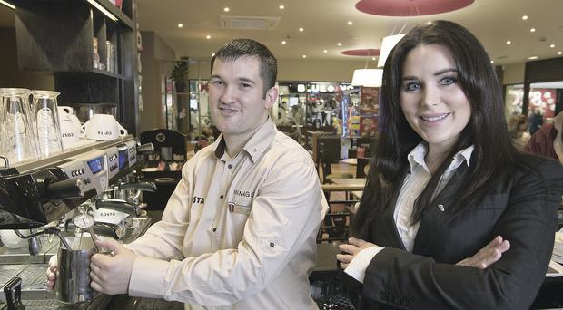 Dervla Arthurs, marketing manager for Costa Ireland, with Michael Smyth, manager of Costa Coffee at the Kennedy Centre in Belfast as the coffee chain announces it is to open three new stores in Northern Ireland