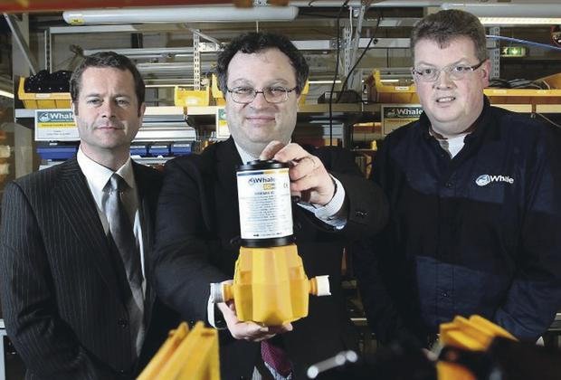 Employment and Learning Minister Stephen Farry on a visit to Whale, with Whale Pumps' management David McComb and Patrick Hurst