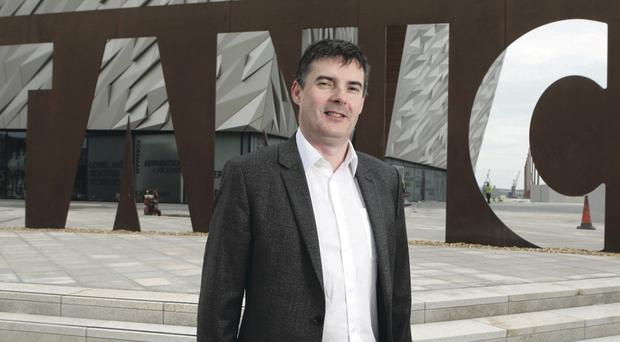 Paul Crowe, Managing Director of Todd Architects, in front of one of the firm's most iconic projects, Titanic Belfast