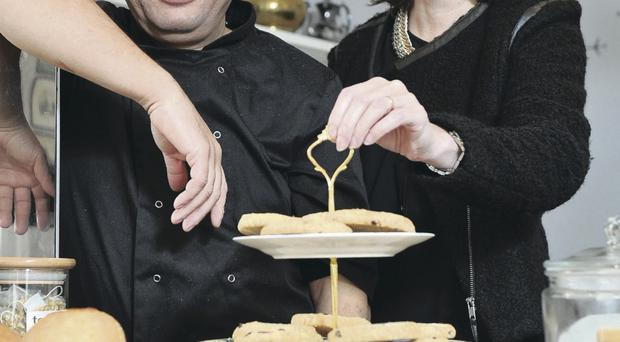 French patisserie chef, Abel Mehablia from La Table Tea Room, has used an Invest Northern Ireland Innovation Voucher to develop and package a range of products to reach new markets. With Abel is Olive Hill from Invest NI